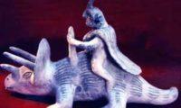Фигурка наших древних предков приручивших динозавров